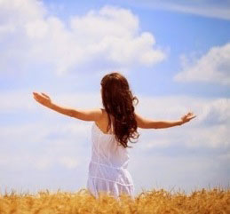 Girl in field with open arms