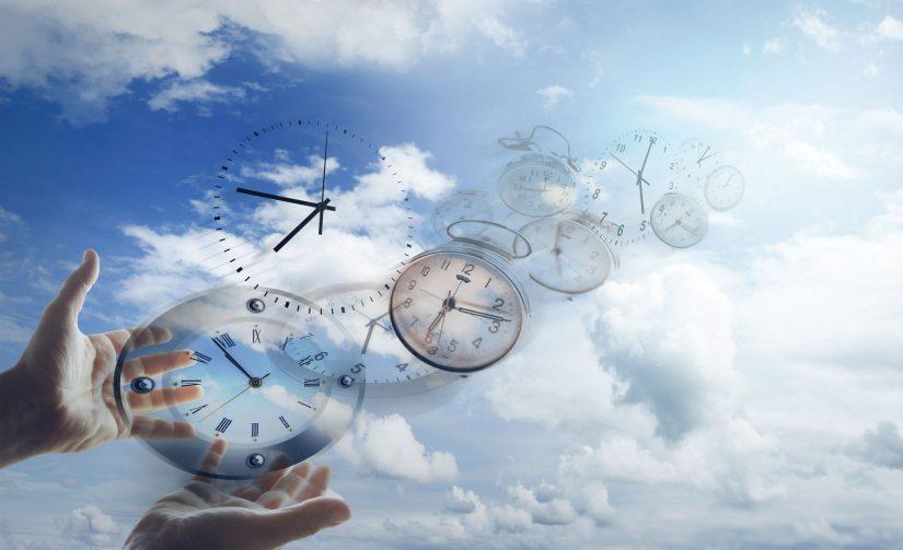 hands holding clocks