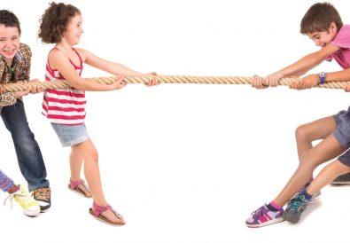 children playing tug-of-war game