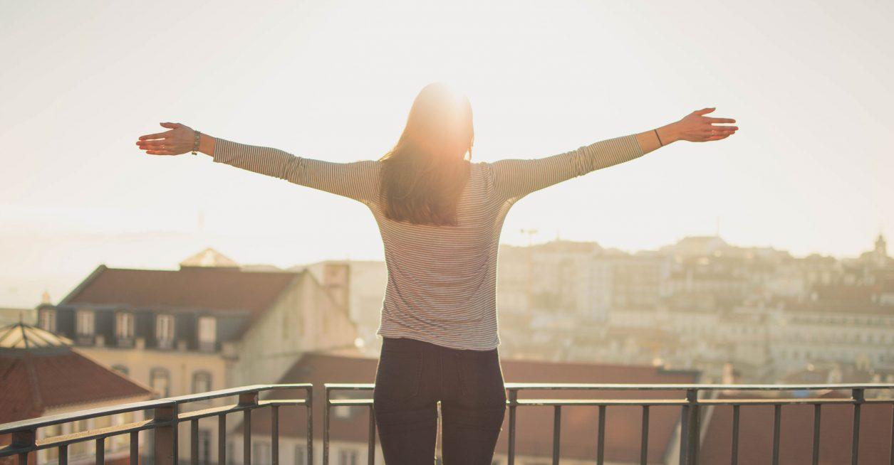 women embracing sunset