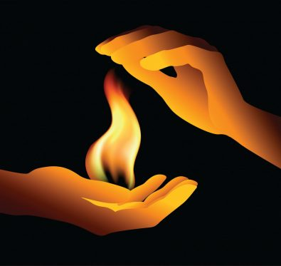 two hands holding a flame