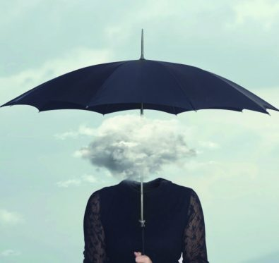 person under umbrella with head looking like a cloud