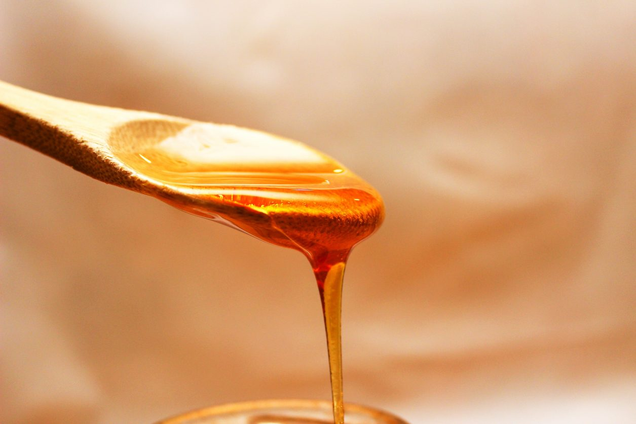 honey dripping from a spoon
