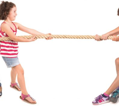 children playing tug-of-war game
