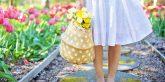 women holding basket of flowers