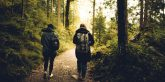 two friends walking in woods
