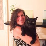 women holding cat